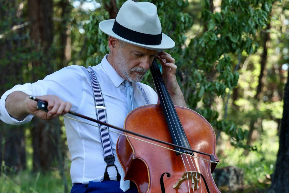 Cellist Daniel Sperry plays at Opening Blessing Ceremony